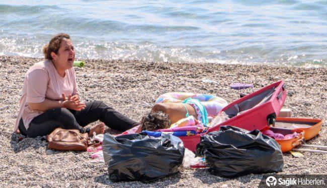 Koronavirüslü kadın sahilde yakalandı